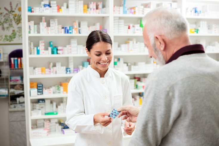 Pharmacist speaking to customer