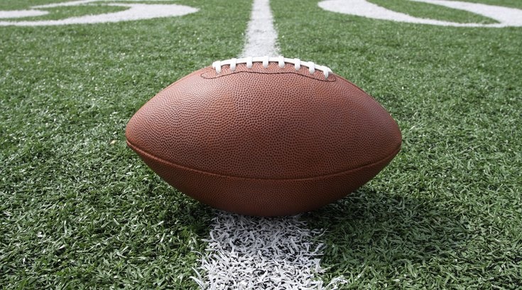 Purchased - Football sitting on field
