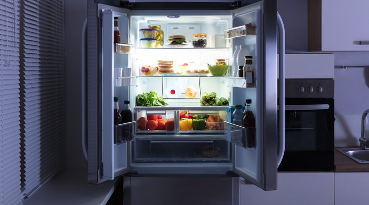 Open Refrigerator In Kitchen stock photo