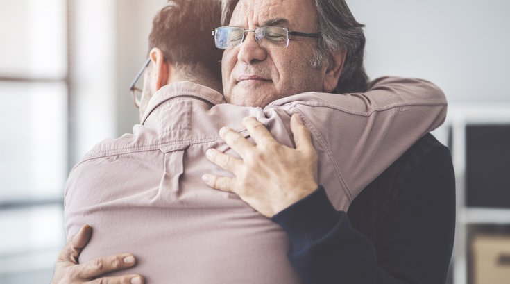 Purchased - Son hugs his father