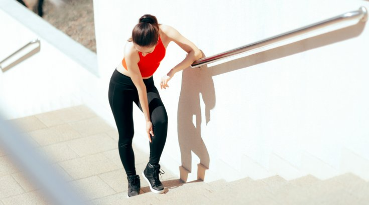 Woman with inflammation on steps