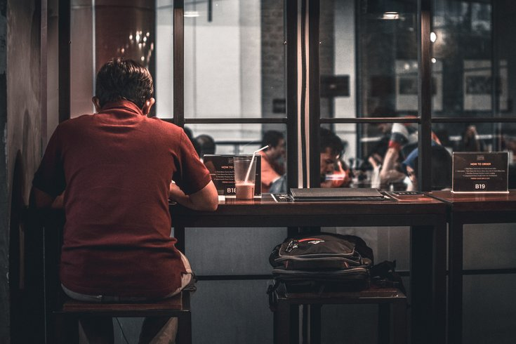 Person eating alone in a restaurant
