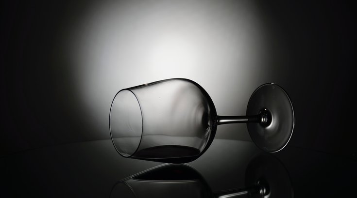 Spilled glass of wine black and white photo