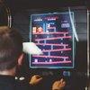 kid playing arcade game
