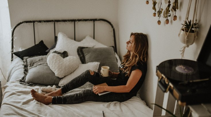 Depressed women sitting in bed