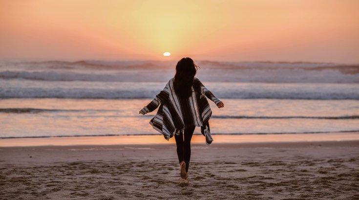 Woman running on a beach