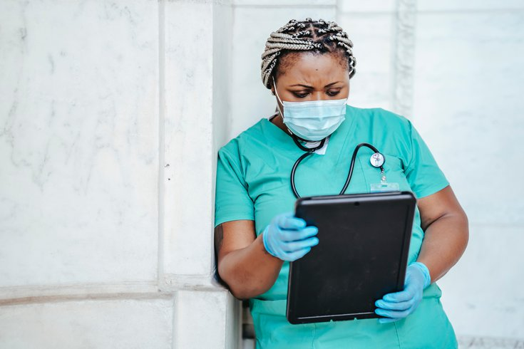 Nurse reviewing medical records