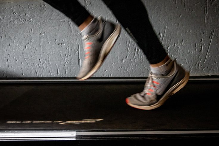 Woman running on treadmill with sneakers