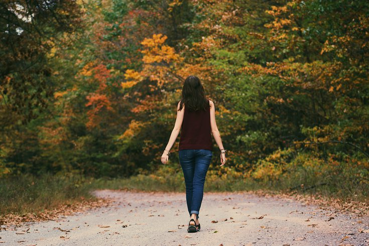 Woman taking a walk on a nature trail