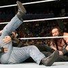 012916_reignsstrowman_WWE