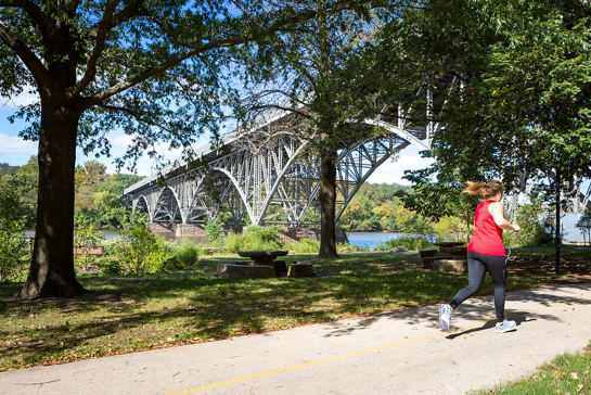 Woman running in park original photo