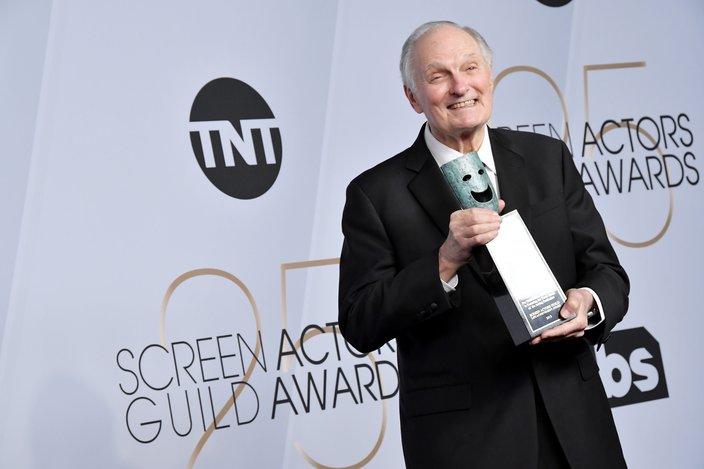 Alan Alda posing with his SAG Life Achievement Award