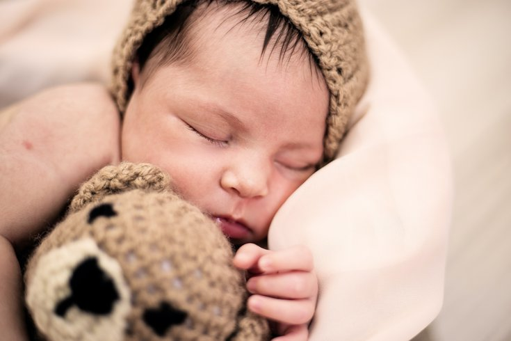 Sleeping baby with stuffed animal