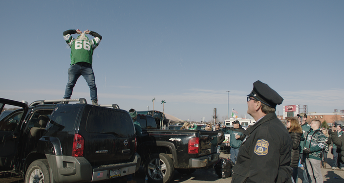 Fans drink in the parking lot at the Linc, as shown in