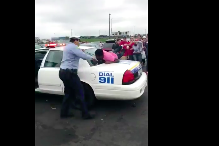 Police Jump & Video: Dude jumps on back of cop car at Temple tailgate | PhillyVoice